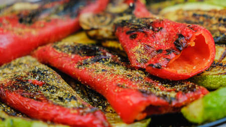 Grilled vegetables in a herb marinade on a grill pan, close up