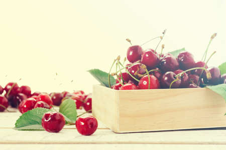 cherry in wooden container box, isolated on white background Stock Photo