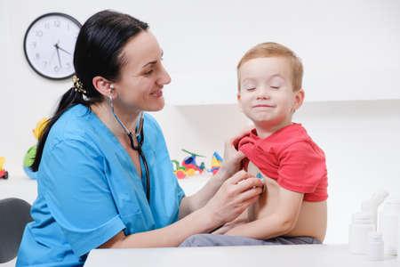 Female doctor using stethoscope to examining little sweet boy Reklamní fotografie