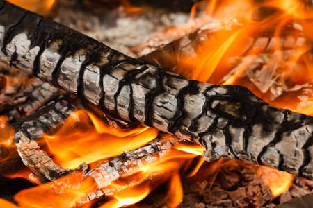 Burning and glowing charcoal with open hot flame and smoke close up Reklamní fotografie