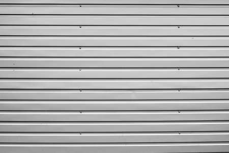 Abstract background corrugated gray metal for wall pattern, metallic.