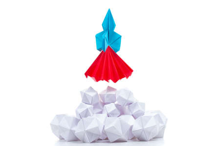 Origami launch background business concept fly paper,  up. Stockfoto