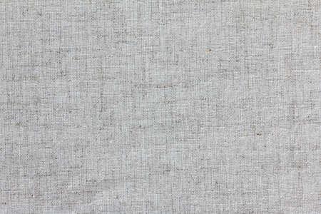Szorstka tekstura płótna z bliska, na białym tle