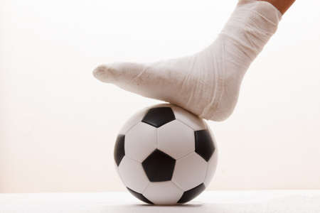 Soccer football player and sport plaster foot leg,  fracture.