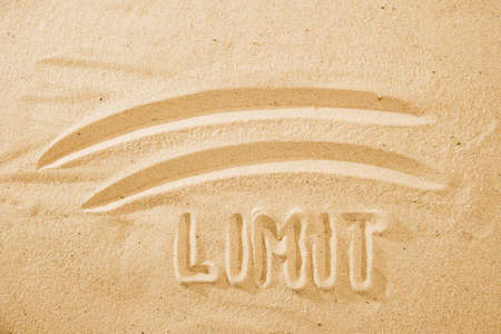 limit concept, line and word on the sand