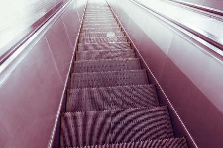 escalator, up and down escalators in public building or metro subway