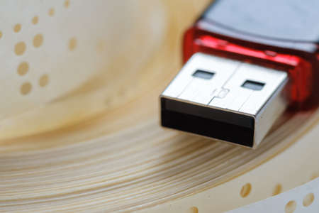 Usb flash drive and obsolete punched tape paper storage,  data. Stock Photo