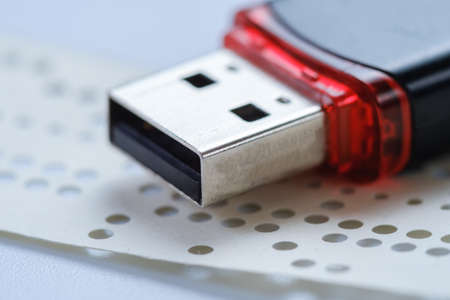 Usb flash drive and obsolete punched tape paper storage,  sd. Stock Photo