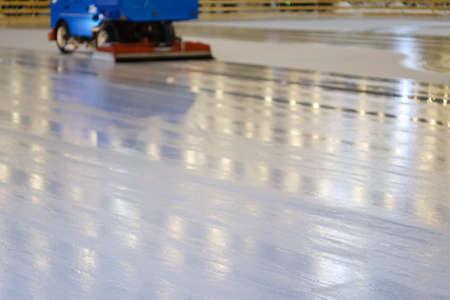 Resurfacer machine levels ice at rink stadium. Winter