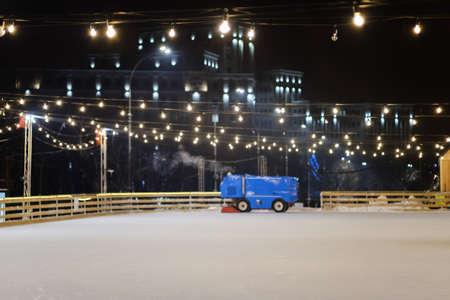 Resurfacer machine levels ice at rink stadium. Renew Stock Photo