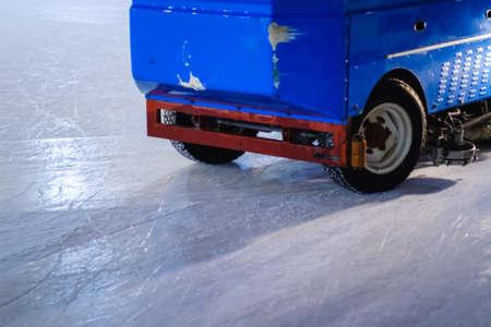 Resurfacer machine levels ice at rink stadium. Resurfacing Stock Photo