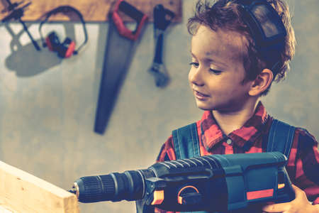 Child and fathers day, concept carpenter tool wood gift,  boy craft. Stock Photo
