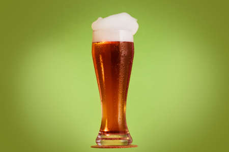 Golden beer in glass with foam, alcohol beverage drink, froth.