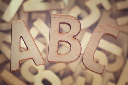 Wooden block ABC alphabet letters set symbols over wood background 写真素材 - 130045895