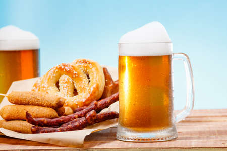Beer glass alcohol drink with food sausage and meat, view.