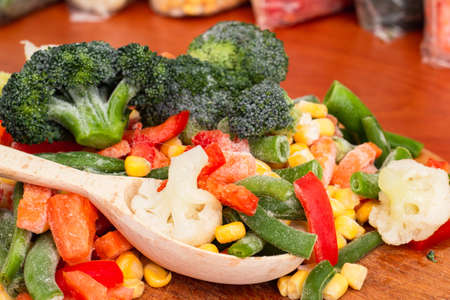 Frozen vegetables in bags, cold healthy diet food, natural homemade.