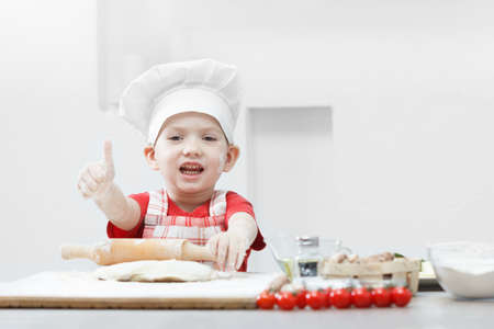 Cooking pizza with little chef, children fun food cook, italian boy.