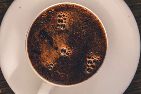 Coffee white cup with foam. Overhead top view