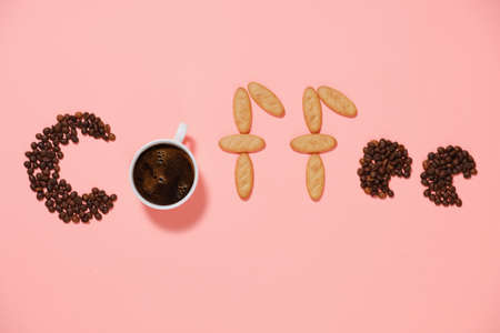 A cup of good morning coffee with donuts and grains on a pink background top view