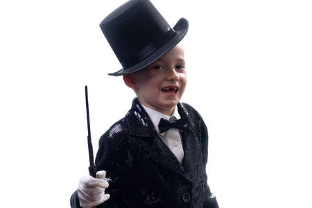 Magician kid illusionist boy in hat, magic show. suit isolated white background