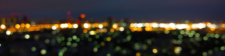 Panorama Blurred abstract background lights, skyline cityscape photo