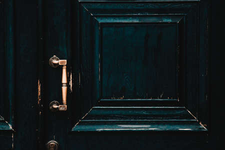 Vintage shabby black doors with gold handle 免版税图像