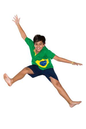 Soccer Boy, jumping, Brazilian flag photo