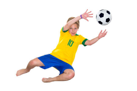 Brazilian Boy, jumping, keeper, yellow and blue Stock Photo