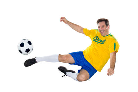 Brazilian Soccer player, jumping, yellow and blue Stock Photo