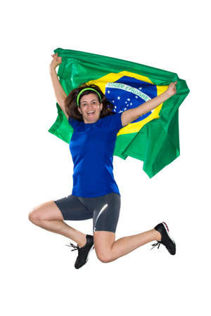 Brazilian female fan, jumping with flag Stock Photo