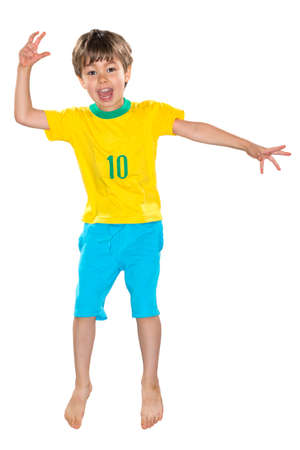 Brazilian Boy, jumping, yellow and blue Stock Photo