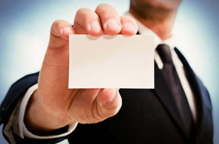 Man s hand showing business card  Black suit and tie  Stock Photo
