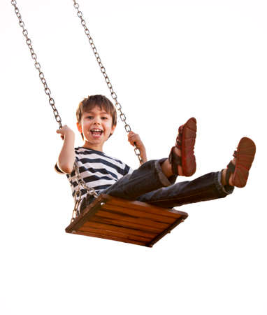 Boy having fun on a swing, on a white background