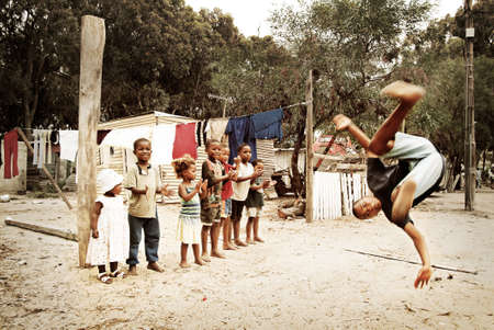 township: Boy jumping. Township in South Africa.