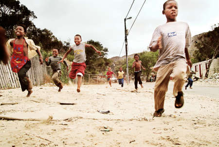 poor child: Children running. Township in South Africa.