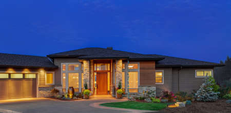 architectural exterior: Home exterior at night: beautiful ranch style home with deep blue sky