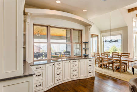cabinetry: Hardwood floors and beautiful cabinetry highlight this stunning kitchendinign area