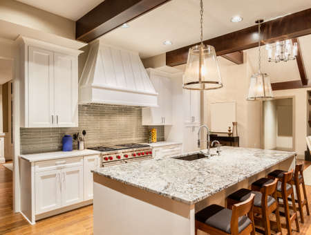 kitchens: Kitchen with Island, Sink, Cabinets, and Hardwood Floors