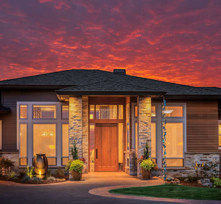 Front elevation of luxury home in evening