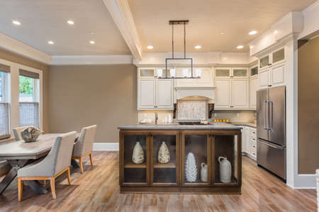 refrigerator kitchen: Kitchen and dining room interior in new luxury home