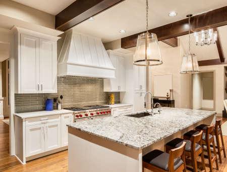 granite kitchen: Kitchen with Island, Sink, Cabinets, and Hardwood Floors