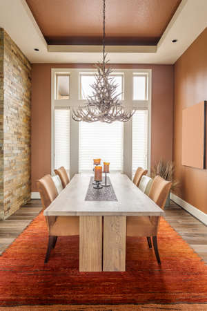 fixture: Dining Room with Entryway, Table, Elegant Light Fixture