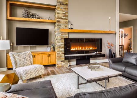 fireplace: Furnished living Room in Luxury Home with Roaring Fireplace