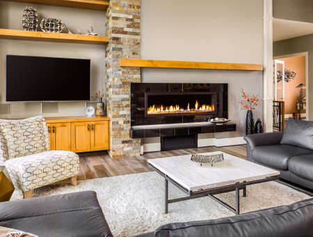 furnished: Furnished living Room in Luxury Home with Roaring Fireplace