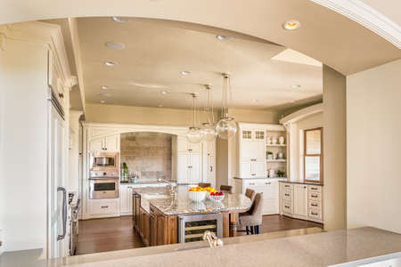 Kitchen with Island, Sink, Cabinetrs, and Hardwood Floors