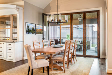 light fixture: Dining Room with Entryway, Table, Elegant Light Fixture