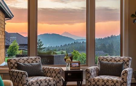 living room interior: Gorgeous SunsetSunrise View from Living Room in New Luxury Home Stock Photo