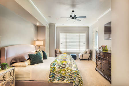 comforter: Furnished master bedroom in new luxury home