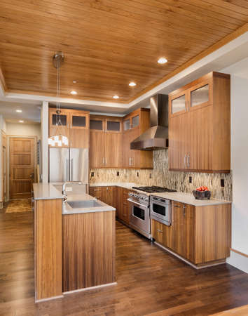 wood floor: Kitchen with Island, Sink, Cabinets, and Hardwood Floors