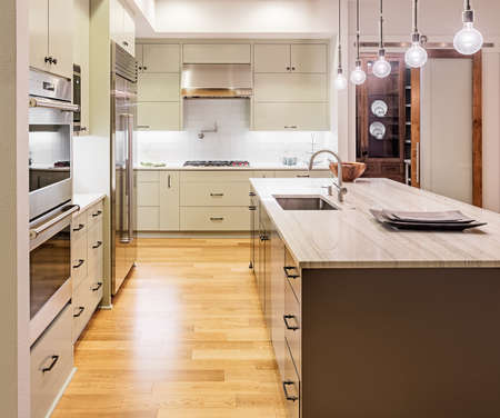kitchen cabinets: Kitchen with Island, Sink, Cabinets, and Hardwood Floors in New Luxury Home
